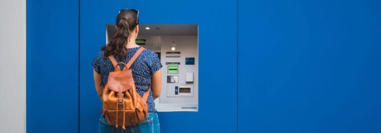 Woman taking money from ATM