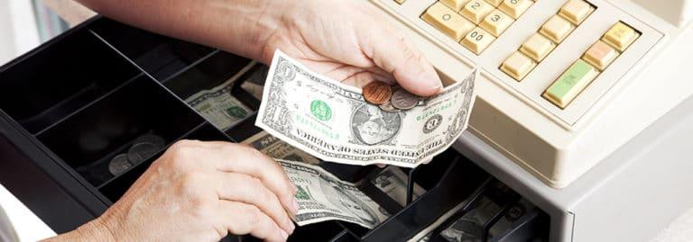 Money being taken from cash drawer