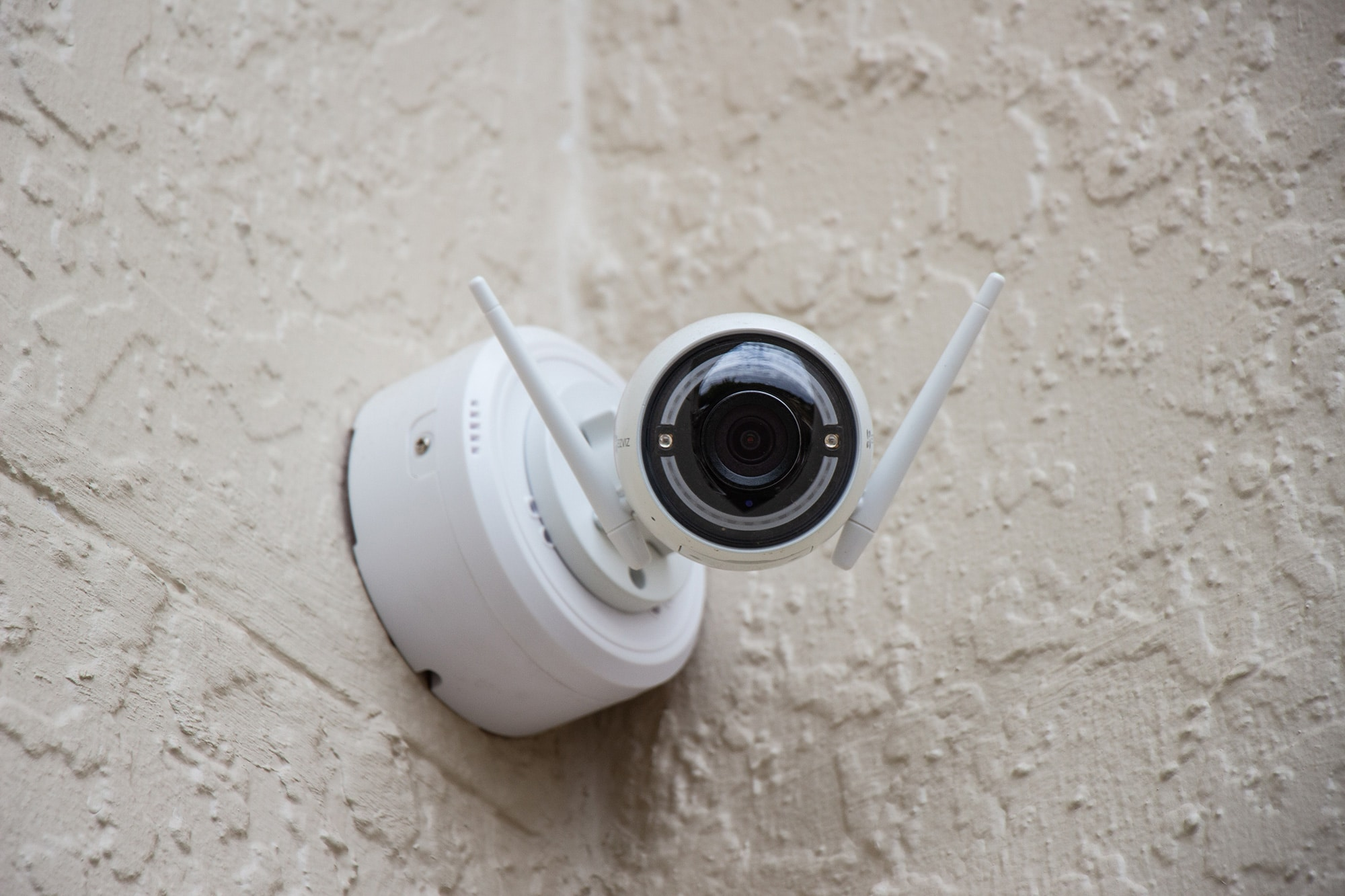 Photo of security camera mounted on a wall